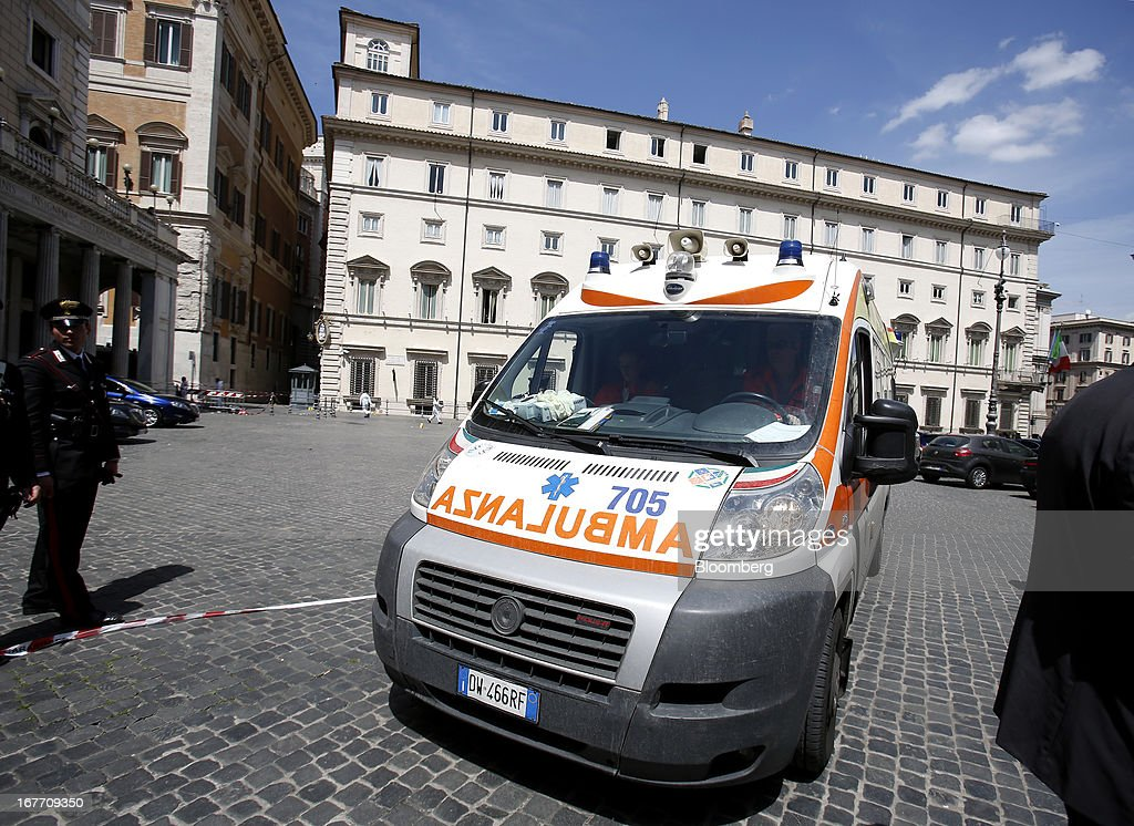 An ambulance leaves following a shooting outside the Chigi Palace in Rome, Italy, on Sunday, April 28, 2013. Two Italian police officers were shot outside the prime minister's office in Rome today by a lone gunman while the country's new premier, Enrico Letta, was being sworn in across town, police said. Photographer: Alessia Pierdomenico/Bloomberg via Getty Images