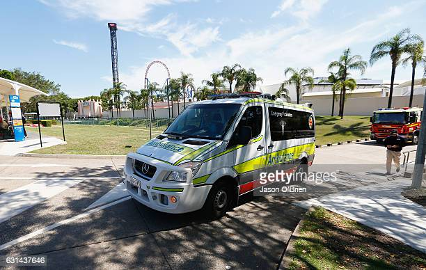 An ambulance leaves Movieworld on January 11 2017 in Gold Coast Australia The Arkham Asylum ride malfunctioned on Wednesday with dozens of passengers...