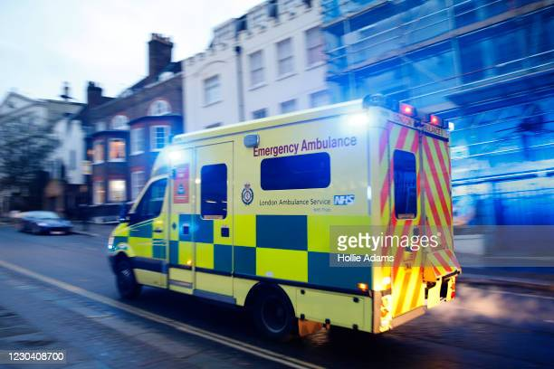 An ambulance leaves the emergency department at the Royal Free Hospital in the Borough of Camden on January 3, 2021 in London, England. The UKhas...