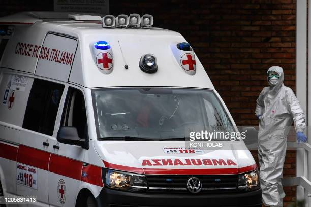 An ambulance leaves the infectious diseases emergency room of Cotugno Hospital in Naples city
