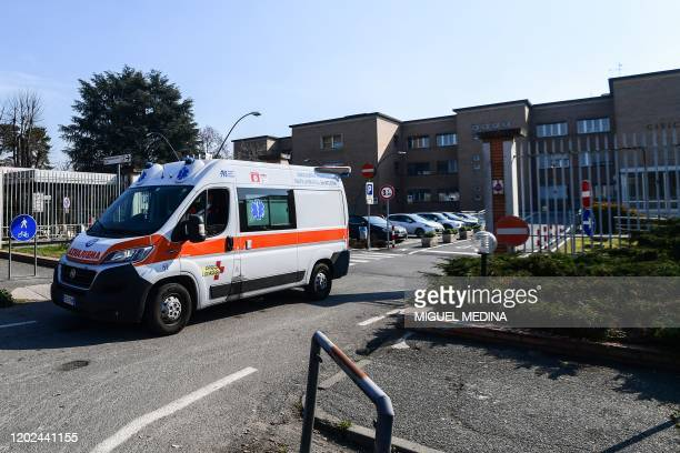 An ambulance leaves the municipal hospital in Codogno, southeast of Milan, on February 22, 2020. - Streets were deserted and residents warned to keep...