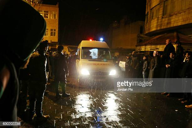 An ambulance leaves the scene following a gun attack on December 18 2016 in AlKarak Jordan A Canadian tourist is believed to be among seven people...