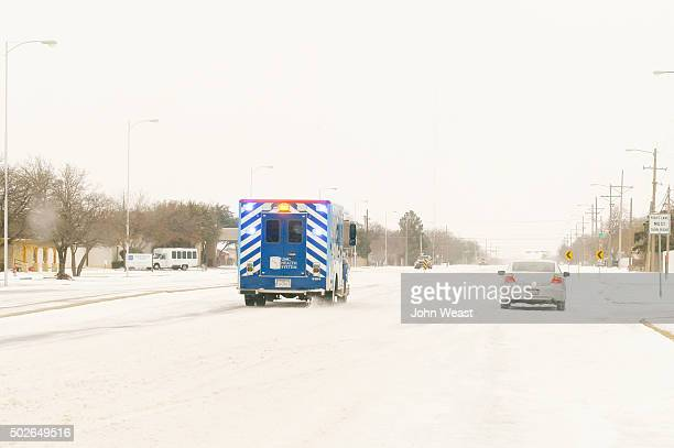 An ambulance makes an emergency run in very poor conditions on December 27, 2015 in Lubbock, Texas. Coming on the heels of several strong tornadoes,...