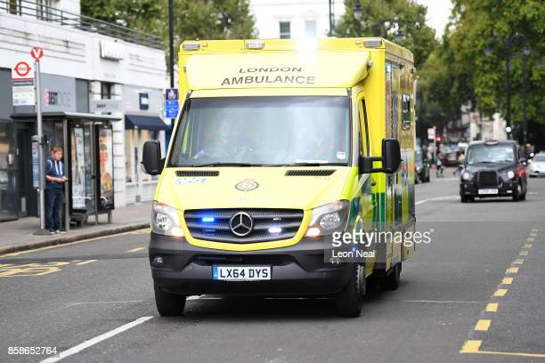An ambulance makes its way to the scene after a car mounted the pavement and collided with pedestrians outside the Natural History Museum on October...