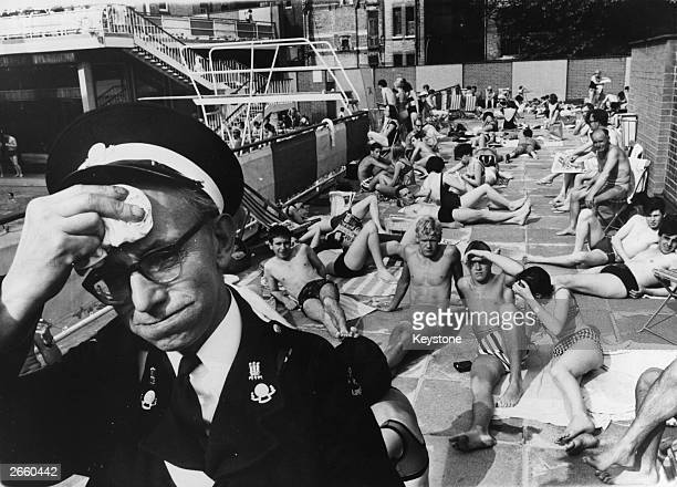 An ambulance man on duty at the Holborn Oasis swimming pool London suffering in the July heat