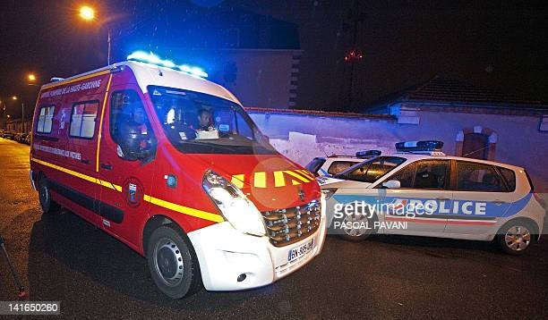 An ambulance of firefighters leaves a street near the place where French policemen members of the RAID special forces unit attempt to arrest a...