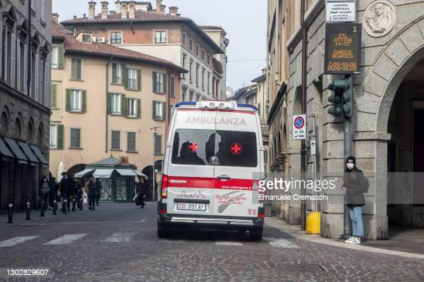 An ambulance of the Italian Red Cross is pictured driving in the streets on February 18, 2021 in Bergamo, Italy. The northern Italian province of...