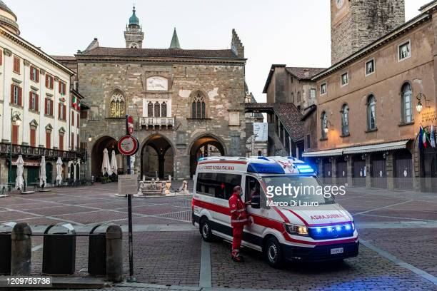 An ambulance of the Italian Red Cross is seen in one of the main squares of the city on April 8 2020 in Bergamo Italy The number of new COVID19 cases...