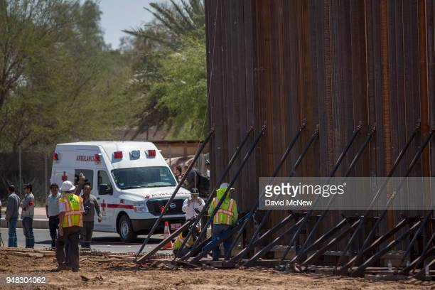 An ambulance on the Mexican side of the border passes as US Department of Homeland Security Secretary Kirstjen M Nielsen tours a replacement border...
