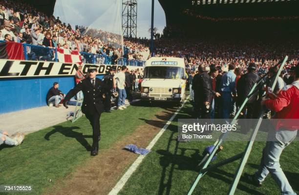 An ambulance on the pitch at Hillsborough football stadium in Sheffield after a human crush at an FA Cup semifinal game between Liverpool and...
