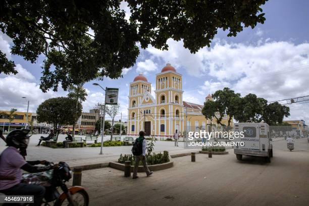 An ambulance passes by the main square of Carmen de Bolivar Bolivar Province Colombia on September 3 2014 Colombian health authorities have denied...