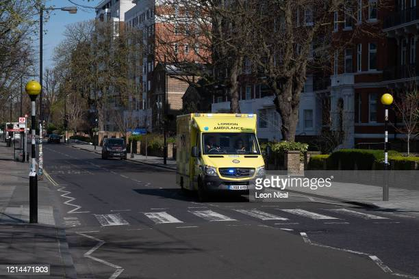 An ambulance passes over the iconic Abbey Road pedestrian crossing on March 24 2020 in London England British Prime Minister Boris Johnson announced...