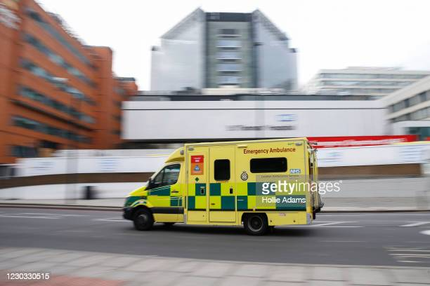 An ambulance passes St Thomas' Hospital emergency department on December 28, 2020 in London, United Kingdom. Patient demand for the London Ambulance...