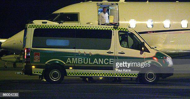 An ambulance receives casualties for transportation to Royal Perth Hospital after a medical evacuation flight from Broome at Perth airport on April...