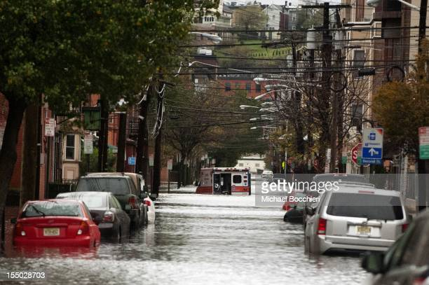 An ambulance sits abandoned in the middle of a flooded street after Hurricane Sandy October 30 2012 in Hoboken New JerseyThe storm has claimed at...