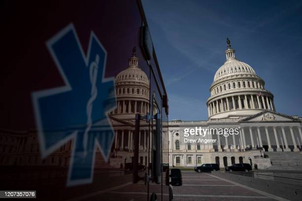 An ambulance sits parked on the plaza outside the US Capitol March 16 2020 in Washington DC After taking the weekend off the Senate will return on...