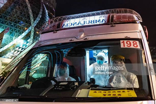 An ambulance stops for a traffic light in front of the Grand Lisboa Hotel on February 4, 2020 in Macau, China. Macau government announced to close...