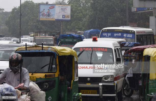 An ambulance stuck during the rain at Civil Line Area on September 23 2017 in New Delhi India The national capital region witnessed cloudy skies and...