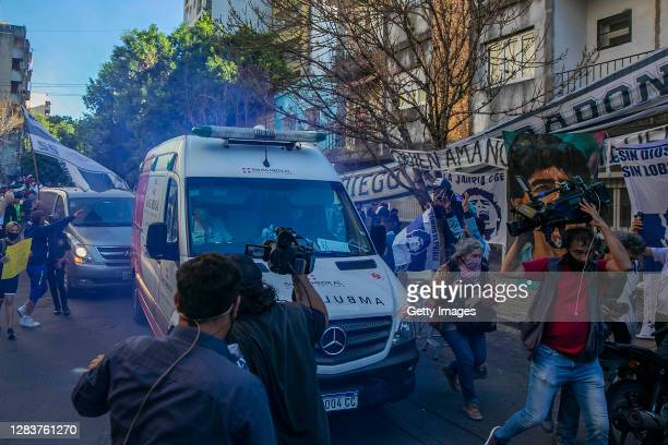 An ambulance taking former football star Diego Maradona leaves Sanatorio Ipensa to take him to Clinica Olivos, where will undergo a surgery to have a...