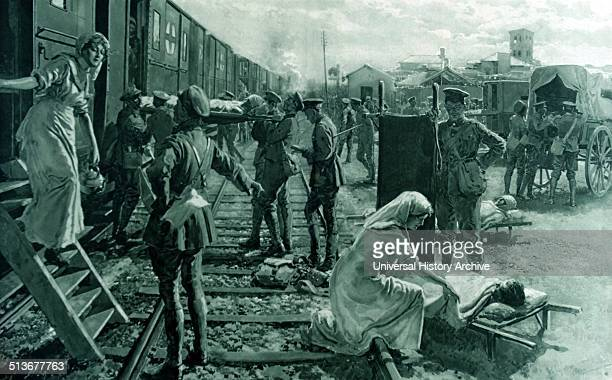 An ambulance train stops at a field hospital in France to offload wounded soldiers world war one 1915