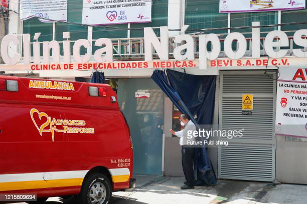 An ambulance transport a patient with symptoms of COVID19 disease at the Naples clinic amid the new virus pandemic on May 27 2020 in Mexico City...