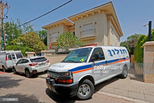 An ambulance transporting the body of Israel's Chinese ambassador, leaves his residence in the Herzliya district on the outskirts of Tel Aviv on May...