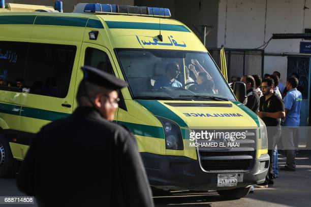 An ambulance transporting wounded Egyptians arrives at a hospital in Cairo's northern suburb of Shubra on May 26 following an attack in which 28...