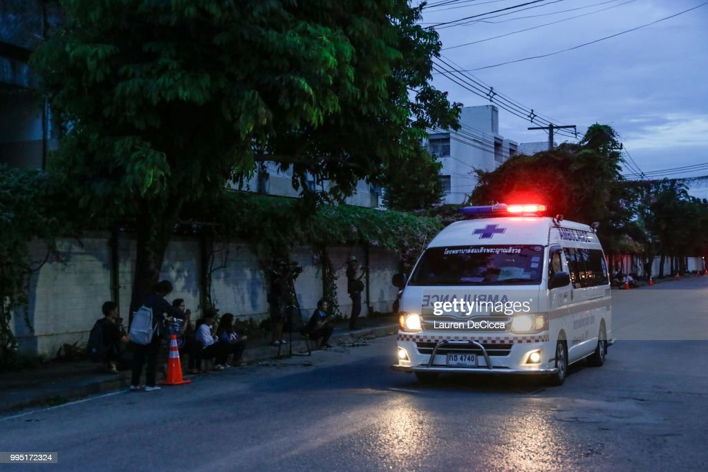 An ambulance transports some of the rescued schoolboys from a helipad to Chiangrai Prachanukroh Hospital on July 10, 2018 in Chiang Rai, Thailand. Divers began an effort to free the 12 boys and their soccer coach on Sunday morning after they were found alive in the cave at northern Thailand. Thai Navy SEALs have confirmed that the boys, aged 11 to 16, and their 25-year-old coach have now all been extracted safely.