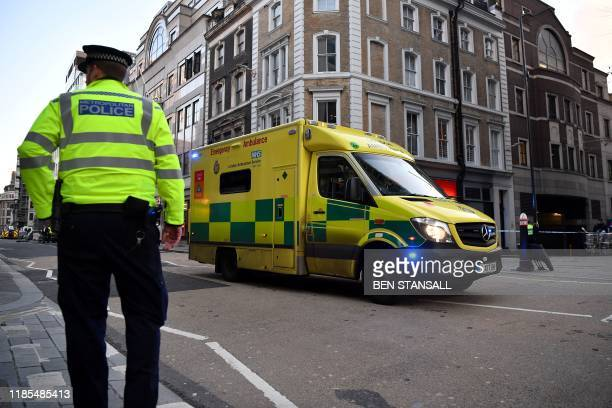 An ambulance travels along Cannon Street from the London Bridge area in central London on November 29 after reports of shots being fired on London...