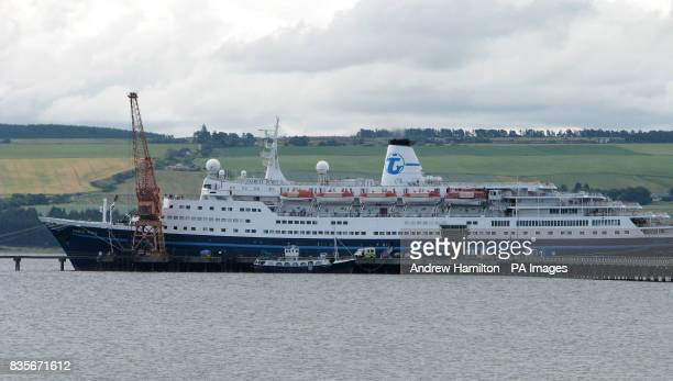 An ambulance visible in front of the Transocean Tours operated Marco Polo which is berthed in Invergordon Easter Ross as experts are trying to...