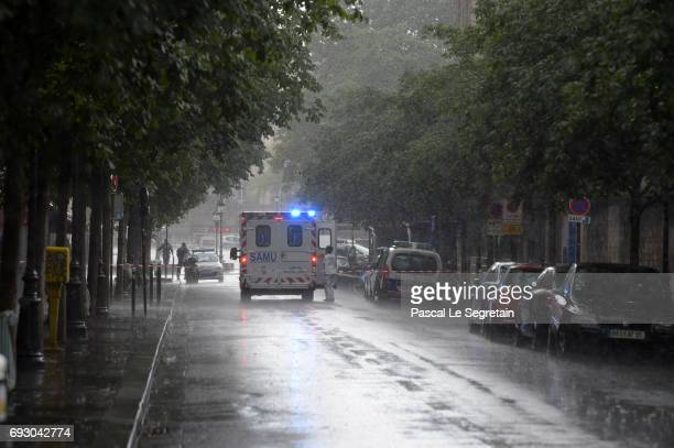 An ambulance waits in the street after a man struck a police officer with a hammer on June 6 2017 in Paris France