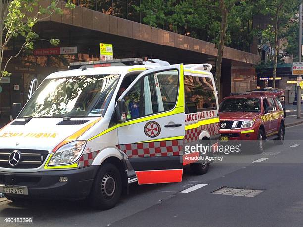 An ambulance waits outside the Lindt Cafe Martin Place on December 15 2014 in Sydney Australia A gunman takes multiple people hostages at Lindt...