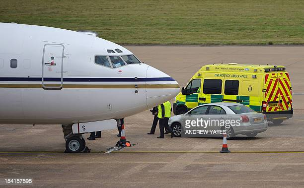 An ambulance waits to transfer 14yearold Malala Yousafzai the Pakistani girl shot in the head by Taliban gunmen for campaigning for the right to an...