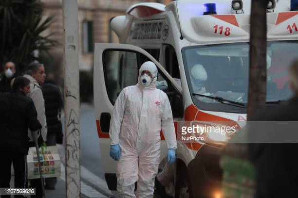 An ambulance with health personnel with high containment protective devices against Coronavirus in Rome for a distress call on March 172020 A week...