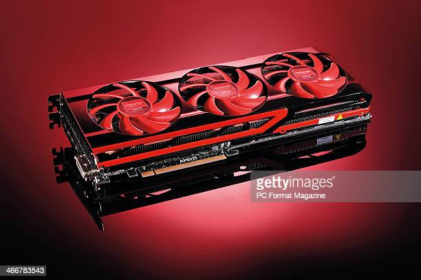 An AMD Radeon HD7990 dualGPU graphics card photographed on a red background taken on April 29 2013