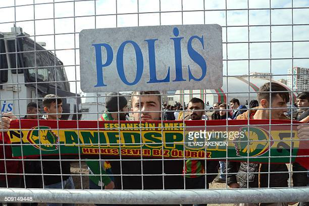 An Amedspor's supporter waves a scarf to cheer his team prior to the Turkish Cup football match between Amed Spor and Fenerbahce Zirrat on February 9...