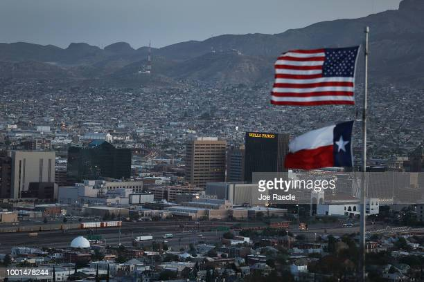 An Amerian and Texas flag are seen flying in front of the skyline of El Paso and Ciudad Juarez on July 18 2018 in El Paso Texas A courtordered July...