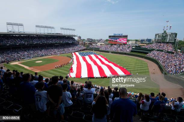 An America flag is stretched out at center field during God Bless America prior to a game between the Tampa Bay Rays and the Chicago Cubs on July 4...
