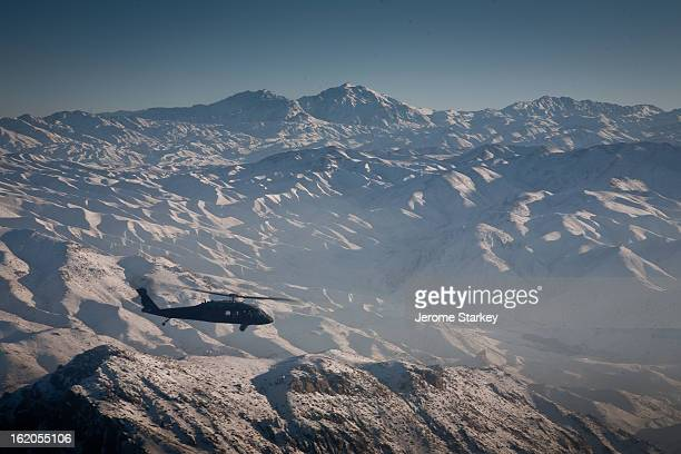 CONTENT] An American Air Force UH60 Black Hawk helicopter flying over the Afghanistan's snow covered Hindu Kush mountains towards Kabul Jan 17 2012...