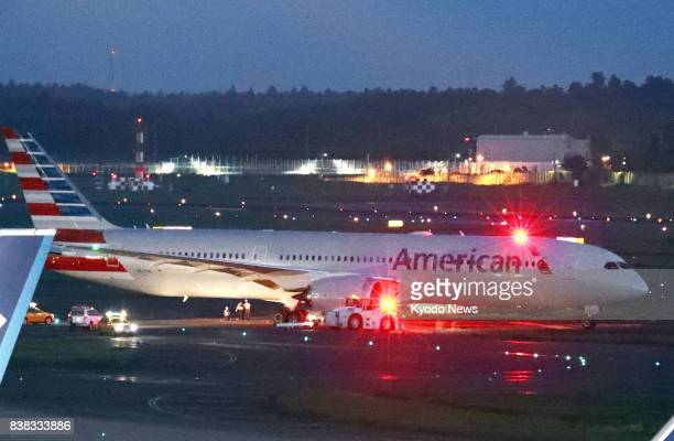 An American Airline Boeing 787 plane bound for Los Angeles is stopped on a taxiway at Narita airport near Tokyo on Aug 24 after it strayed onto a...