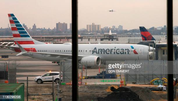 An American Airlines 737 Max sits at the gate at LaGuardia airport on March 13 2019 in New York The ban on the Boeing 737 MAX aircraft became...