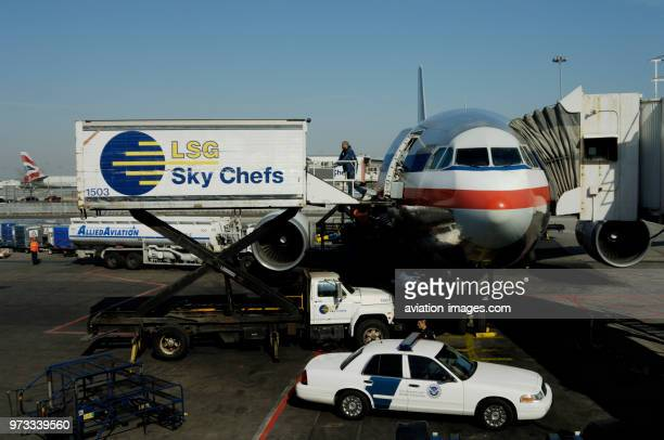 An American Airlines Airbus A300600R parked at the terminal with LSG Sky Chefs catering trucks AlliedAviation bowser US Customs and Border Protection...