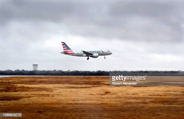 An American Airlines Airbus A319 passenger jet takes off on a rainy day from San Antonio International Airport in Texas