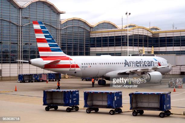 An American Airlines Airbus A320 passenger plane is serviced at a gate at Ronald Reagan Washington National Airport in Washington DC