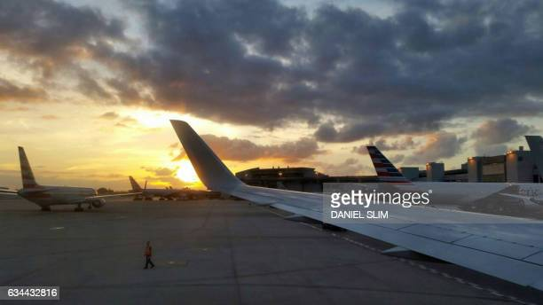 An American Airlines airliner taxis on the tarmac of Miami International Airport on January 1st 2017 Airline shares rose on February 9 2017 after...