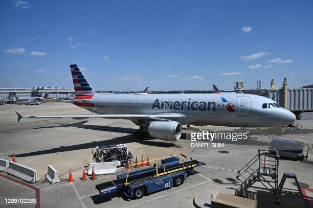 An American Airlines airplane is seen at gate at Washington National Airport on April 11 2020 in Arlington Virginia Many flights are canceled due to...
