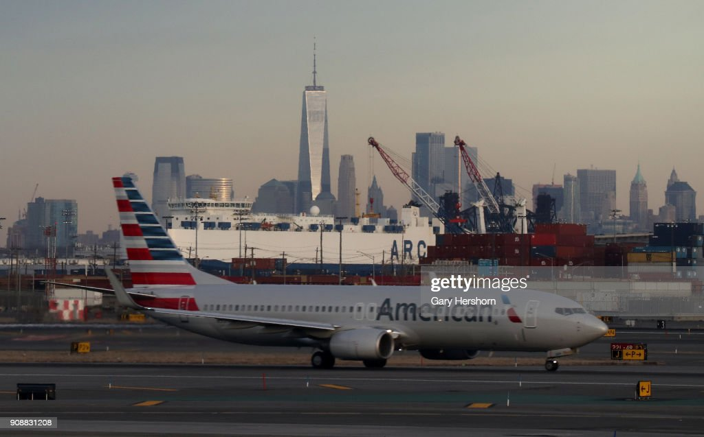 An American Airlines Airplane Passes The Skyline Of Lower