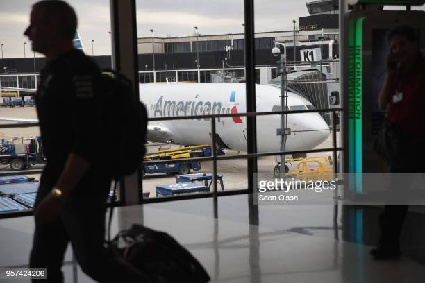 An American Airlines aricraft sits at a gate at O'Hare International Airport on May 11 2018 in Chicago Illinois Today American Airlines held a...