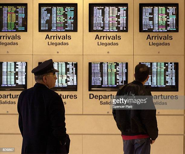 An American Airlines arrival and departure board displays flight times March 2 2001 at John F Kennedy International airport in New York City A...