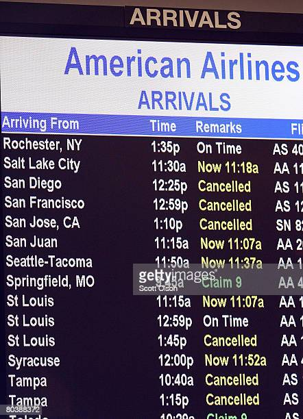 An American Airlines arrival board shows several cancelled flights at O'Hare Airport March 26 2008 in Chicago Illinois American Airlines cancelled...